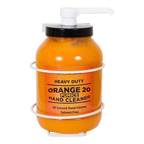 Orange pumice hand cleaner in wall dispenser